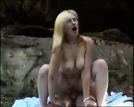 blond girl gets analized on beach - scene 10