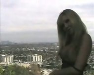 Cindy Pucci stripping in front of nice Panorama - scene 4