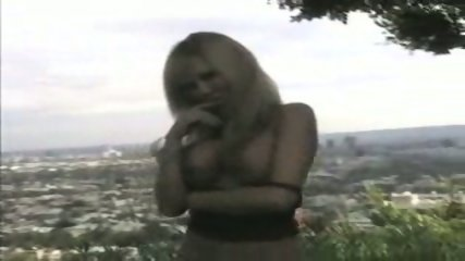 Cindy Pucci stripping in front of nice Panorama - scene 7