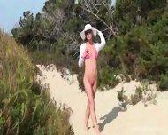 Nikkita in a micro bikini outdoor - scene 1