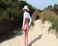 Nikkita in a micro bikini outdoor - scene 2