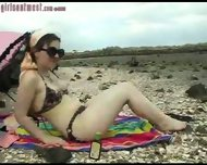 Girl shows bits off at beach - scene 9