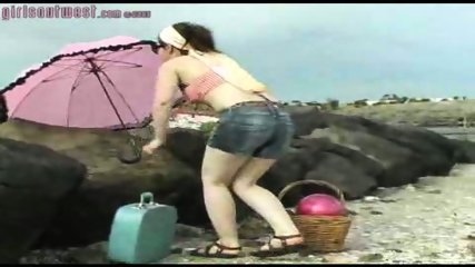 Girl shows bits off at beach - scene 1