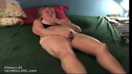 Mature slut masturbates on bed - scene 6