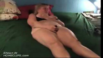 Mature slut masturbates on bed - scene 7