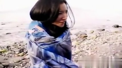 Asian slut is on the beach - scene 12