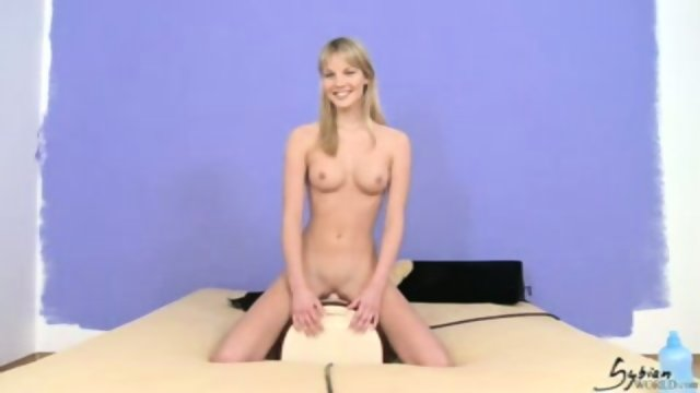 Pretty Rose rides the Sybian.