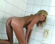 Hot blond chick taking a bath - scene 8