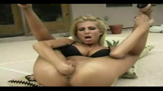 blonde fisting herself very hard