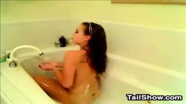 Bath girl masturbating in