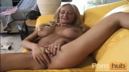 Busty mature masturbates on the couch - scene 5