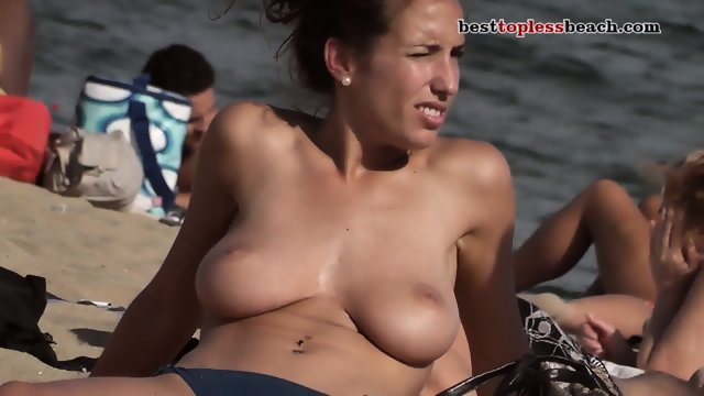 Wonderful busty babe goes Topless on the Beach - scene 8