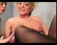 Mature woman shows a younger girl a good time - scene 11