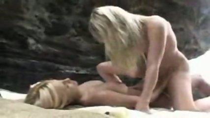 lesbian strapon fuck on beach