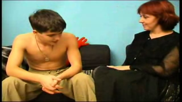 older woman seducing young stud on couch 1