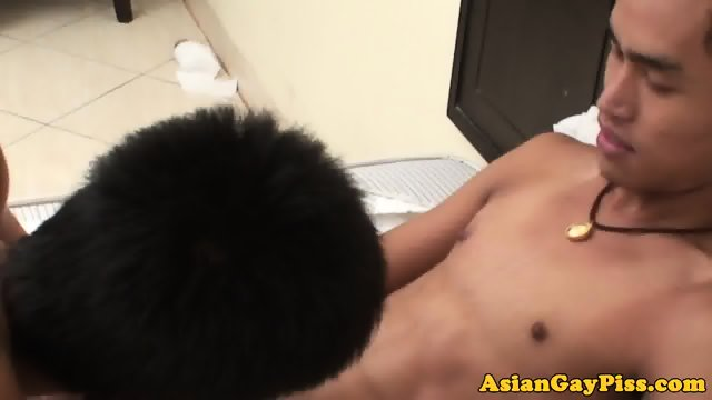 Asian twink pissing before masturbating