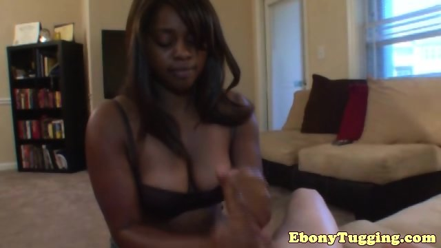 Busty black handjob babe tugging on dick