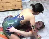 really cool body painting by two hot girls - scene 11